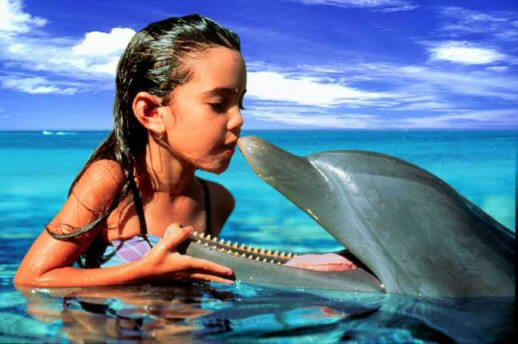 Girl with dolphin, subliminal communication -- photograph by Elan Sun Star